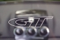 "Preview: Removeable wind deflector clear with outline ""GT"" logo"