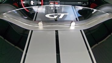"Fix mounted wind deflector clear with filled ""GT"" logo"